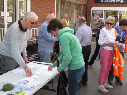 Volunteers Registering and getting their briefing.