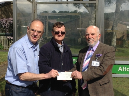 Chairman of Alton Easbrooke & Wooteys RA recieves cheque from David Simpkins of the Alton Society